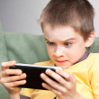Boy playing game console — Stock Photo