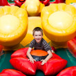 Boy in inflatable playground - Stock Photo