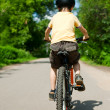 Kid riding bicycle — Stock Photo