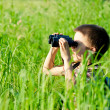 Kid with binocular - Stock Photo