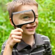 Kid with loupe — Stock Photo
