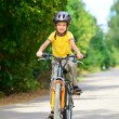 Kid on a bike — Stock Photo