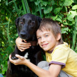 Stock Photo: Kid with a dog