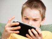 Boy playing game console — Foto Stock