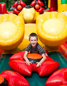 Boy in inflatable playground — Stock Photo
