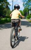 Kid riding bicycle — Stock Photo