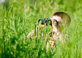 Kid with binocular — Stock Photo