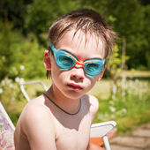 Kid in swimming googles — Stock Photo