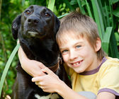 Kid with a dog — Stock Photo
