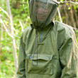 Man in encephalitis protective clothing — Stock Photo #14898781