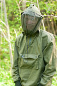 Man in encephalitis protective clothing — Stock Photo
