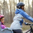 Child in bike seat - Stock Photo