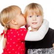 Little girls sharing a secret - Foto Stock