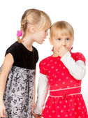 Little girls sharing a secret — Stock Photo