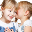 Little girls sharing a secret — Stock Photo #17606441