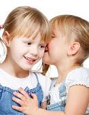 Little girls sharing a secret — Stock Photo
