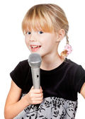 Child with microphone singing — 图库照片