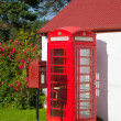 British red postbox and telephone box — Stock Photo