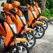 Scooters for rent - Stock Photo