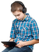 Kid playing with a tablet computer — Stock Photo