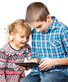 Children playing with a tablet computer — Stock Photo
