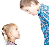 Children sticking out tongues — Stock Photo
