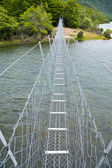 Suspension walking bridge — Stock Photo
