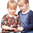 Girls playing with a tablet computer — Stock Photo