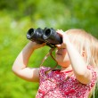 Child looking through binoculars — Stock Photo #26071433