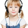 Little girl wearing headphones — Stock Photo