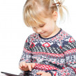 Child playing with a tablet computer — Stock Photo