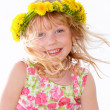 Stock Photo: Close-up of cute little girl wearing floral wreath