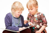 Children reading a book — Stock Photo