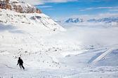 Skier on a piste — Stock Photo