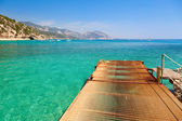 Pier at sardinian beach — Stock Photo