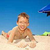 Sandy boy on a beach — Stock Photo