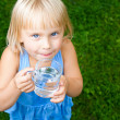 Child with cap of water — Stock Photo