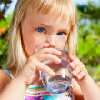 Child drinking water — Stock Photo