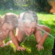 Children playing in a summer garden — Stock Photo