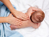 Baby back massage — Stock Photo