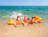 Children playing on a beach — Stock Photo
