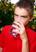 Kid drinking water — Stock Photo