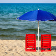 Chairs with umbrella — Stock Photo