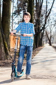 Boy with kick scooter — Stock Photo