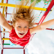 Happy child on a jungle gym — Stok fotoğraf #48134005