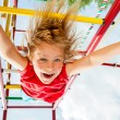 Happy child on a jungle gym — Foto de Stock   #48134005