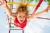 Happy child on a jungle gym — Stock Photo