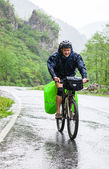Cycle tourist on a road — Stock Photo