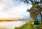 Riverside campsite — Stock Photo