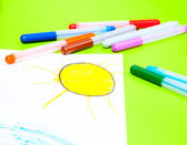 Drawing of sun and colorful pens — Stock Photo